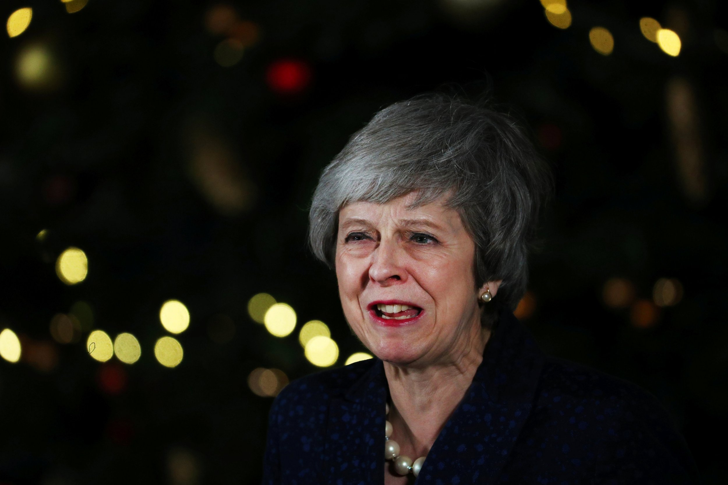 Britain's Prime Minister Theresa May speaks outside 10 Downing Street after a confidence vote by Conservative Party Members of Parliament (MPs), in London, Britain December 12, 2018. REUTERS/Hannah McKay