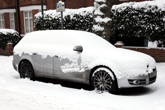 heavy snow covers a car in london