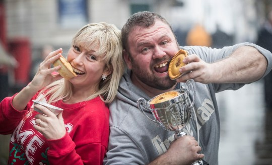 World Pie Eating Champion Martin Appleton-Clare (right) with the fastest lady Vicky Lindley after competing during World Pie Eating Championships 2017 in Wigan.