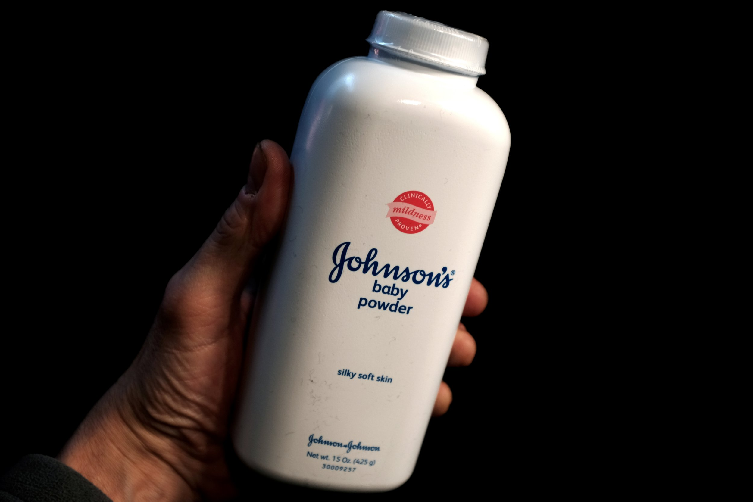 A bottle of Johnson and Johnson Baby Powder is seen in a photo illustration taken in New York, February 24, 2016. REUTERS/Mike Segar/Illustration/File Photo GLOBAL BUSINESS WEEK AHEAD PACKAGE SEARCH BUSINESS WEEK AHEAD 17 OCT FOR ALL IMAGES - S1BEUHKTISAA
