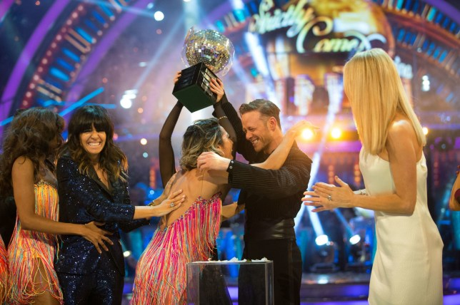 For use in UK, Ireland or Benelux countries only BBC handout photo dated 15/12/18 of Strictly Come Dancing 2018 winners Kevin Clifton and Stacey Dooley (obscured) celebrating with the glitterball trophy and Karen Clifton (centre). PRESS ASSOCIATION Photo. Issue date: Saturday December 15, 2018. See PA story SHOWBIZ Strictly. Photo credit should read: Guy Levy/BBC/PA Wire NOTE TO EDITORS: Not for use more than 21 days after issue. You may use this picture without charge only for the purpose of publicising or reporting on current BBC programming, personnel or other BBC output or activity within 21 days of issue. Any use after that time MUST be cleared through BBC Picture Publicity. Please credit the image to the BBC and any named photographer or independent programme maker, as described in the caption.