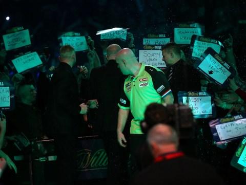Darts 'fan' throws beer at Michael van Gerwen but Dutchman rallies to down Alan Tabern