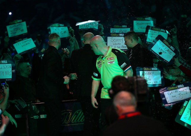 Michael van Gerwen is showered in beer by a member of the crowd as he prepares to walk to the Oche during day three of the William Hill World Darts Championships at Alexandra Palace, London. PRESS ASSOCIATION Photo. Picture date: Saturday December 15, 2018. Photo credit should read: Mark Kerton/PA Wire
