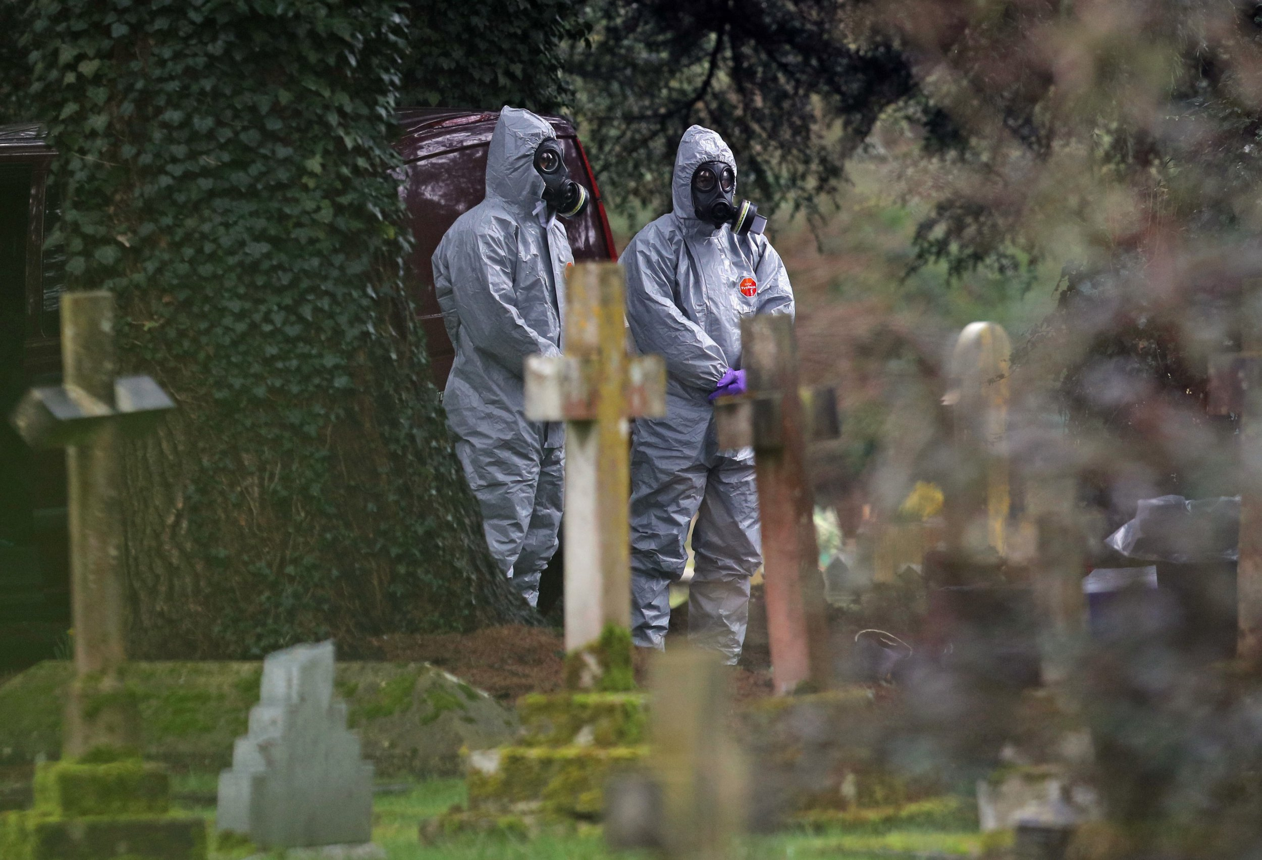 REVIEW OF THE YEAR PICS 2018 File photo dated 10/03/18 of forensic officers in gas masks at the London Road cemetery in Salisbury, Wiltshire, as investigations continued at the cemetery where former Russian double agent Sergei Skripal's wife and son were laid to rest. PRESS ASSOCIATION Photo. Issue date: Sunday December 16, 2018. See PA story XMAS Year. Photo credit should read: Andrew Matthews/PA Wire