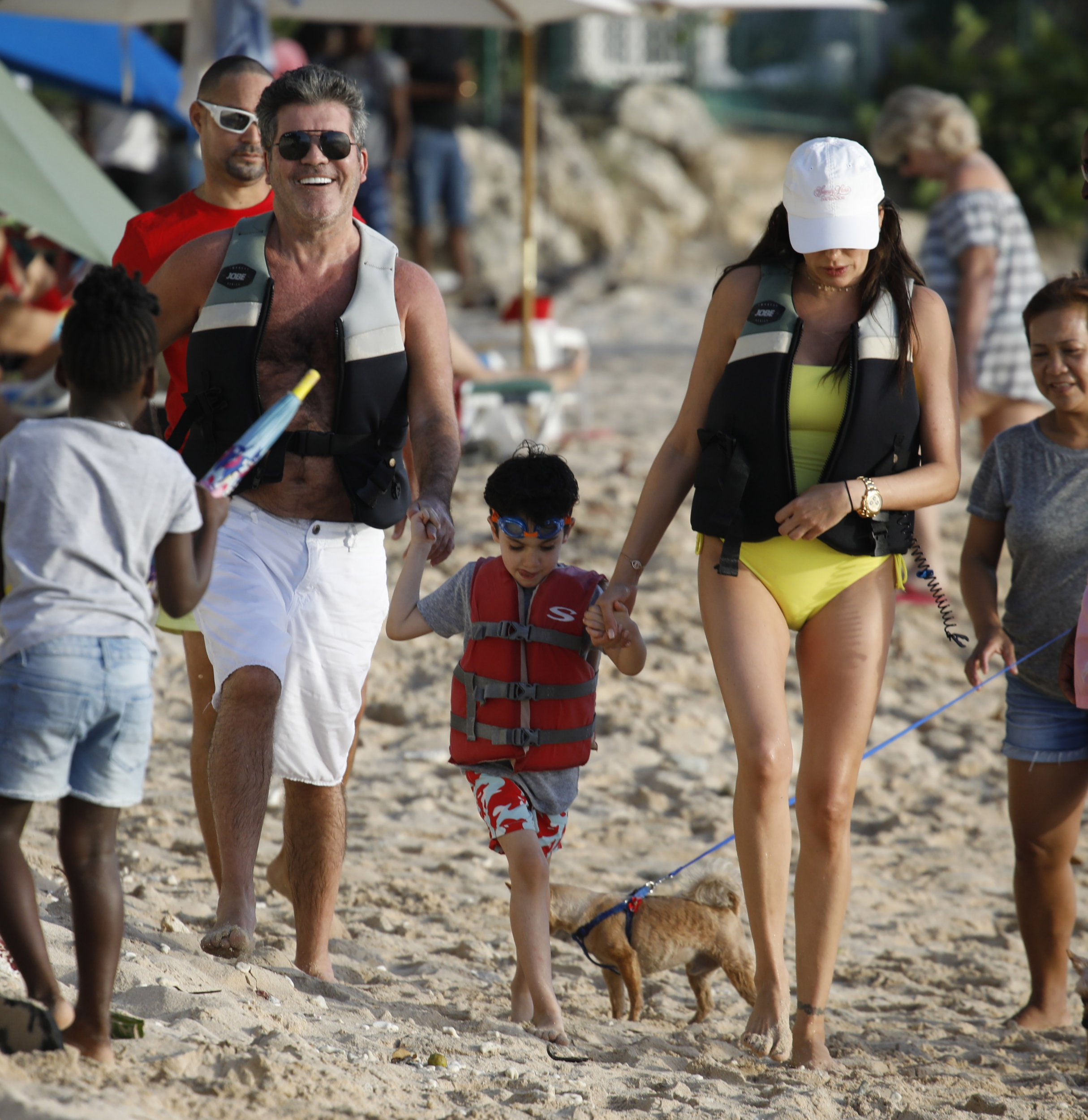 Simon Cowel And Son Eric Return Back To The Beach With Mum Lauren Silverman After There Jet Ski Ride In Barbados Pictured: Simon Cowell Eric And Lauren Silverman Ref: SPL5050197 161218 NON-EXCLUSIVE Picture by: Ralph / SplashNews.com Splash News and Pictures Los Angeles: 310-821-2666 New York: 212-619-2666 London: 0207 644 7656 Milan: 02 4399 8577 photodesk@splashnews.com World Rights,