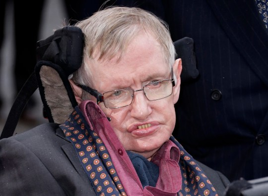 FILE - In this March 30, 2015, file photo, Professor Stephen Hawking arrives for the Interstellar Live show at the Royal Albert Hall in central London. Hawking, whose brilliant mind ranged across time and space though his body was paralyzed by disease, has died, a family spokesman said early Wednesday, March 14, 2018. (Photo by Joel Ryan/Invision/AP, File)