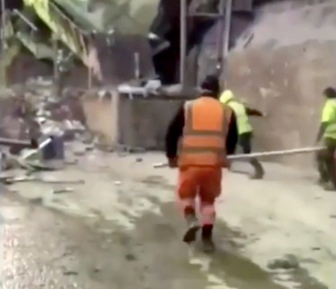 A gang of warehouse workers attempt to kill as many rats as possible with their boots and blunt instruments, in footage posted to social-media this week. APPALLING footage shows laughing warehouse workers clubbing rats to death with wooden sticks as the rodents try to flee. In the shocking clip, the hi-vis clothed workers KICK the squealing rats in the air and batter them with blunt instruments. The brutal video was shared across social media yesterday. It is unknown where the footage was filmed but the incident is believed to have taken place in England. The vile footage ? which is filmed by a laughing bystander on a mobile phone ? begins by showing the workers assembled and waiting for the rats with around a pile of garbage. The men stand ready with wooden sticks. ... SEE COPY AND VID ... PIC BY NEWS DOG MEDIA ... 0121 517 0019