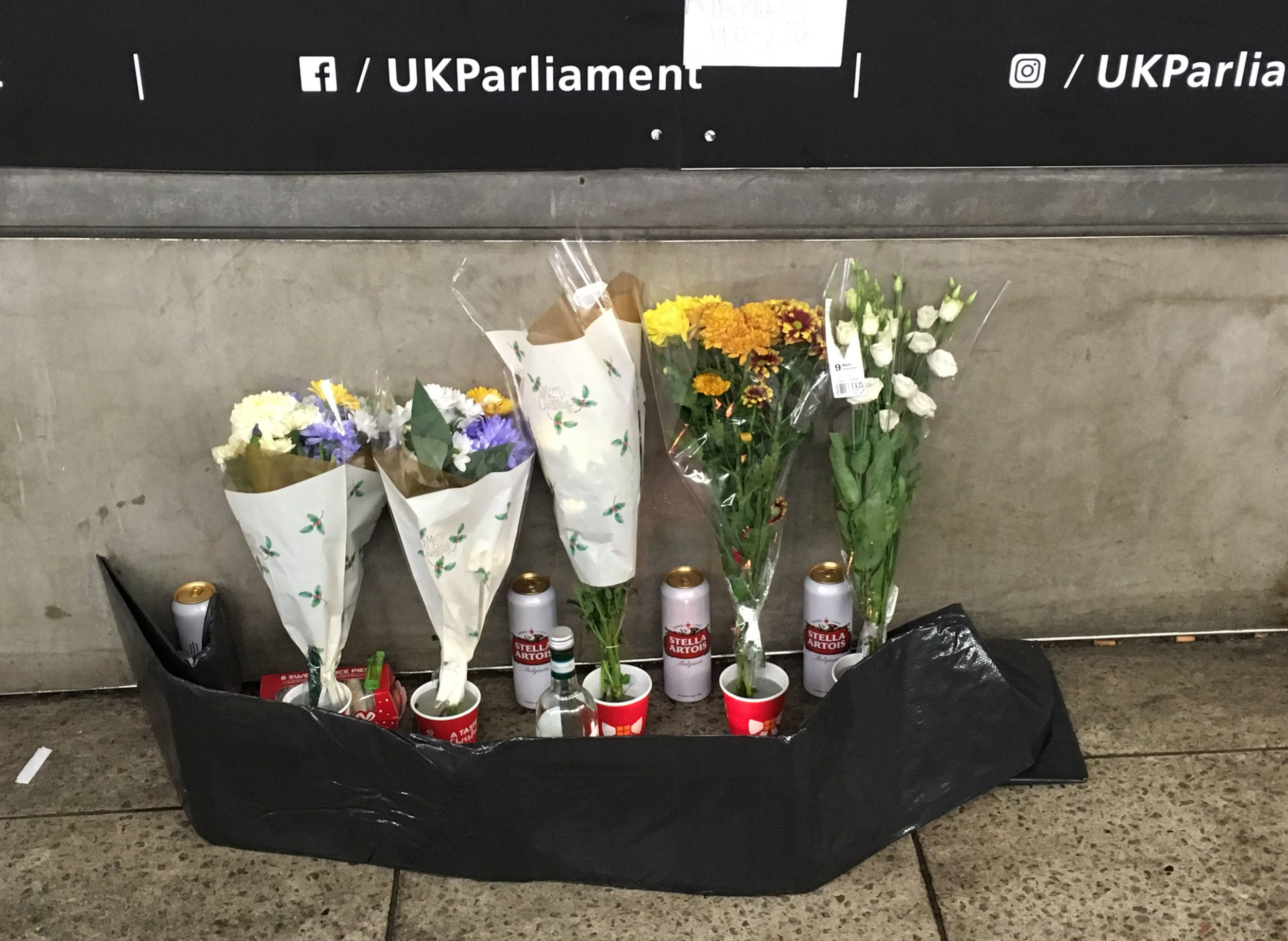 Floral tributes lay outside the Parliament entrance near Westminster underground station, where homeless man known as Gyula Remes, was found dying outside the entrance to the Houses of Parliament. PRESS ASSOCIATION Photo. Picture date: Wednesday December 19, 2018. British Transport Police were called to Westminster Underground station at about 11pm on December 18 and besides giving him first aid, Mr Remes died at a Central London hospital in the early hours of December 19. See PA story POLICE Homeless. Photo credit should read: Jasmine Cameron-Chileshe/PA Wire