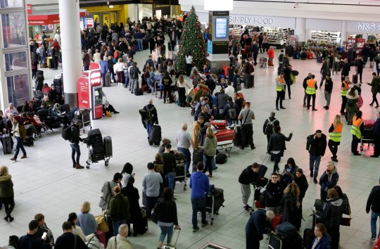 People queue at Gatwick airport, near London, as the airport remains closed with incoming flights delayed or diverted to other airports, after drones were spotted over the airfield last night and this morning, Thursday, Dec. 20, 2018. London's Gatwick Airport remained shut during the busy holiday period Thursday while police and airport officials investigate reports that drones were flying in the area of the airfield. (AP Photo/Tim Ireland)