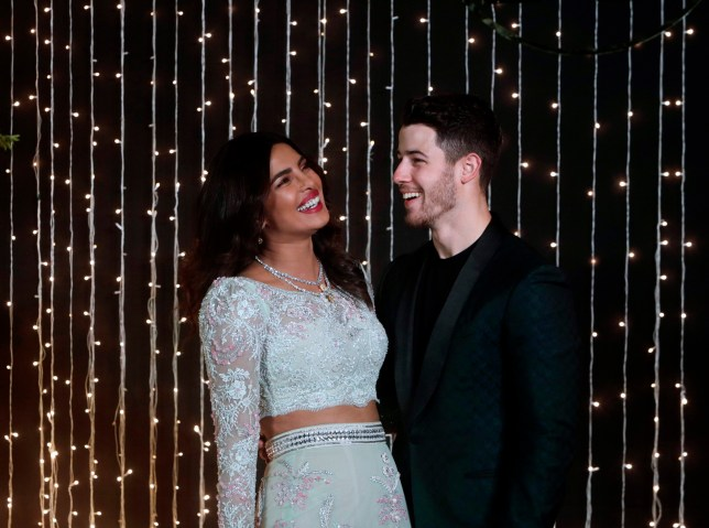 Bollywood actress Priyanka Chopra and musician Nick Jonas pose for photographs at their wedding reception in Mumbai, India, Thursday, Dec 20, 2018. (AP Photo/Rajanish Kakade)