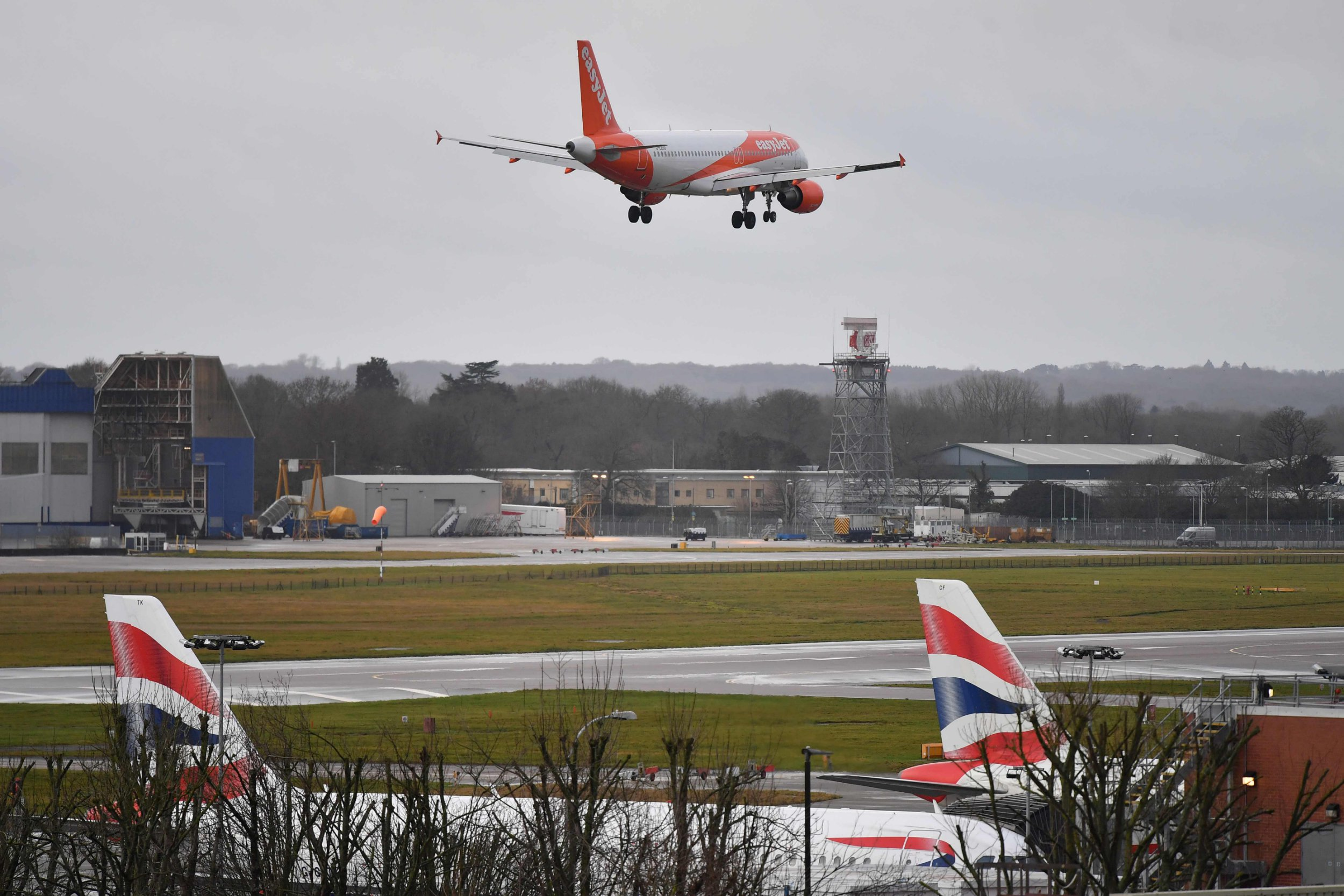 "An EasyJet Airbus 320-214 aircraft prepares to land at London Gatwick Airport, south of London, on December 21, 2018, as flights resumed following the closing of the airfield due to a drones flying. - British police were Friday considering shooting down the drone that has grounded flights and caused chaos at London's Gatwick Airport, with passengers set to face a third day of disruption. Police said it was a ""tactical option"" after more than 50 sightings of the device near the airfield since Wednesday night when the runway was first closed. (Photo by Ben STANSALL / AFP)BEN STANSALL/AFP/Getty Images"