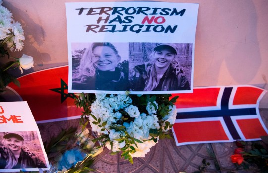 This picture taken on December 21, 2018 shows a combo photo murdered Danish student Louisa Vesterager Jespersen (L) and Nowegian Maren Ueland placed on top of flowers and between the flags of Morocco an Norway as Moroccans pay tribute to the Scandinavian victims. - The bodies of the 24-year-old Danish student 28-year-old Norwegian were found on December 17, after the two friends had pitched their tent at an isolated mountain site two hours' walk from the tourist village of Imlil. (Photo by FADEL SENNA / AFP)FADEL SENNA/AFP/Getty Images