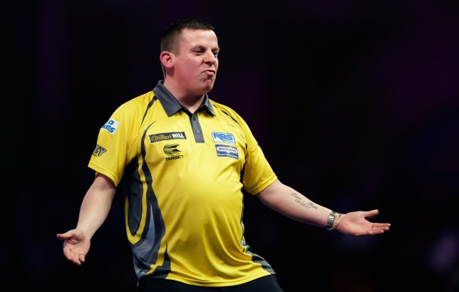 Dave Chisnall celebrates winning a set against Kim Huybrechts during day ten of the William Hill World Darts Championships at Alexandra Palace, London. PRESS ASSOCIATION Photo. Picture date: Saturday December 22, 2018. Photo credit should read: John Walton/PA Wire