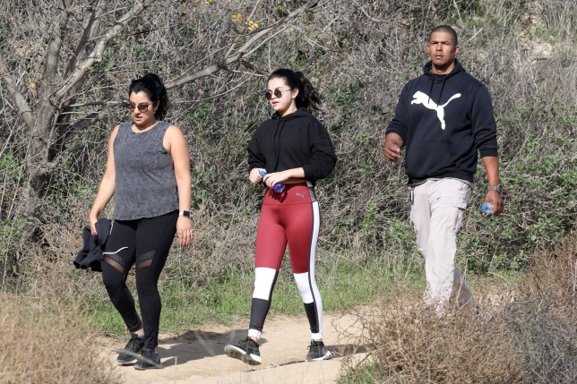 Los Angeles, CA - Selena Gomez tries to stay healthy with a hike after being released from rehab. Selena is seen on her 3rd hike this week as she enjoys the exercise with her bodyguard and a friend. Pictured: Selena Gomez BACKGRID USA 22 DECEMBER 2018 USA: +1 310 798 9111 / usasales@backgrid.com UK: +44 208 344 2007 / uksales@backgrid.com *UK Clients - Pictures Containing Children Please Pixelate Face Prior To Publication*