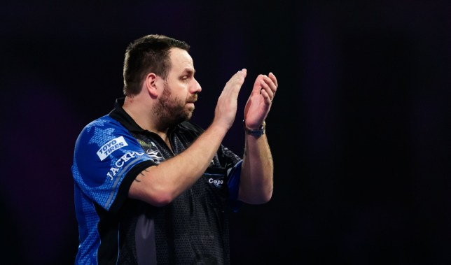 Adrian Lewis celebrates defeating Darius Labanauskas during day eleven of the William Hill World Darts Championships at Alexandra Palace, London. PRESS ASSOCIATION Photo. Picture date: Sunday December 23, 2018. Photo credit should read: John Walton/PA Wire