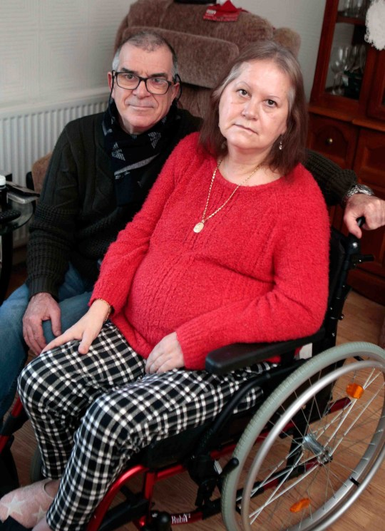 A husband has lashed out after his paralysed wife was abandoned on her bedroom floor for hours after falling and spraining her ankle. After her fall, Gigi Fois rang 999 and requested medical assistance for his 60-year-old wife Gillian, who suffered a severe stroke more than six years ago leaving her partially paralysed. Mr Fois, 65, was told they could be waiting for four hours and that in the end no-one turned up at all that morning. Gigi Fois and his wife Gill of Dalton who had to wait over four hours for an ambulance after Gill suffered a fall.