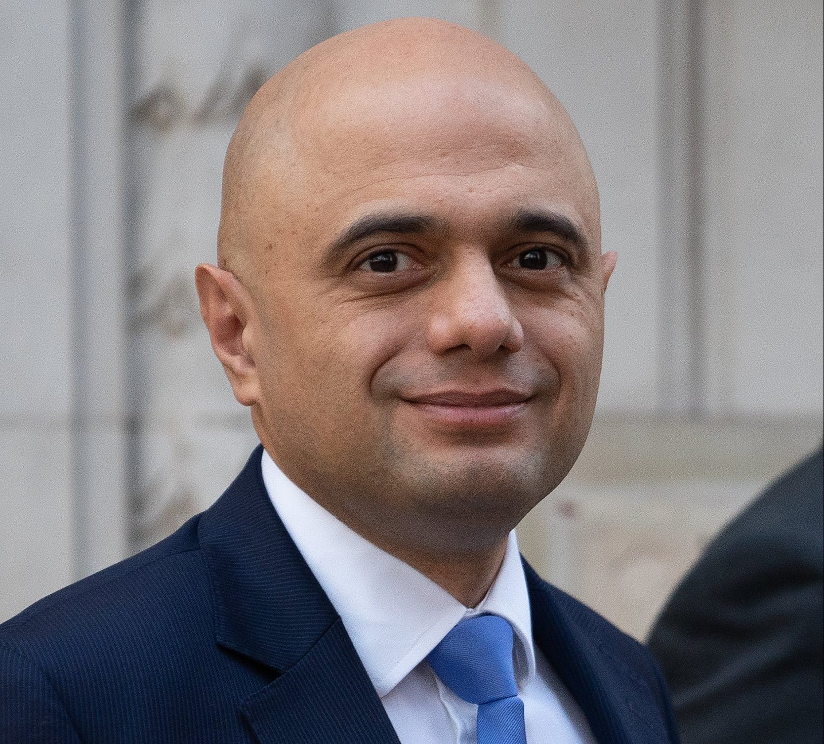 LONDON, ENGLAND - DECEMBER 03: Home Secretary Sajid Javid leaves Millbank studios after appearing on the BBC Today radio programme on December 03, 2018 in London, England. Members of Parliament will vote on the Brexit deal Ms May has reach with the European Union on December 11. (Photo by Leon Neal/Getty Images)