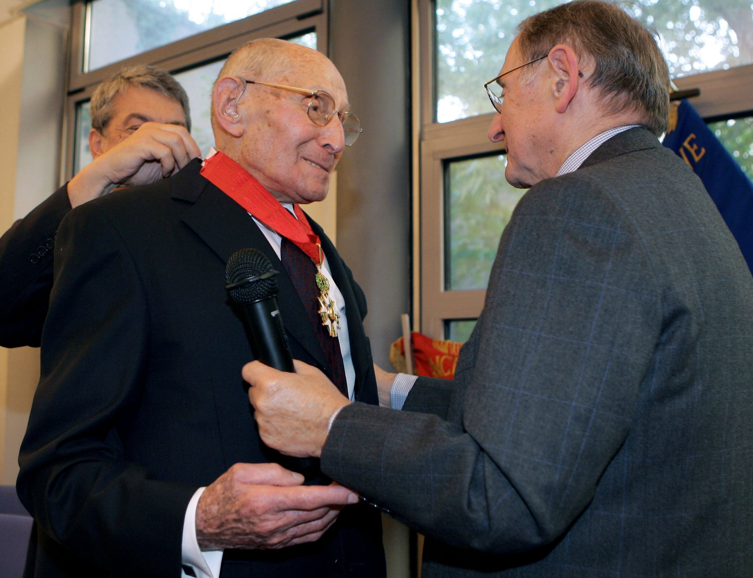 (FILES) In this file photo taken on September 19, 2005 Georges Loinger (L), head of the French Jewish Resistance Association (Association de la R??sistance juive de France, ARJF), is awarded with the title of Commandeur de la Legion d'Honneur (commander of the Legion of Honour) in Paris, France. - Georges Loinger died on December 29, 2018, at the age of 108. He was a French resistance fighter during World War II, and rescued hundreds of Jewish children. (Photo by Jacques DEMARTHON / AFP)JACQUES DEMARTHON/AFP/Getty Images