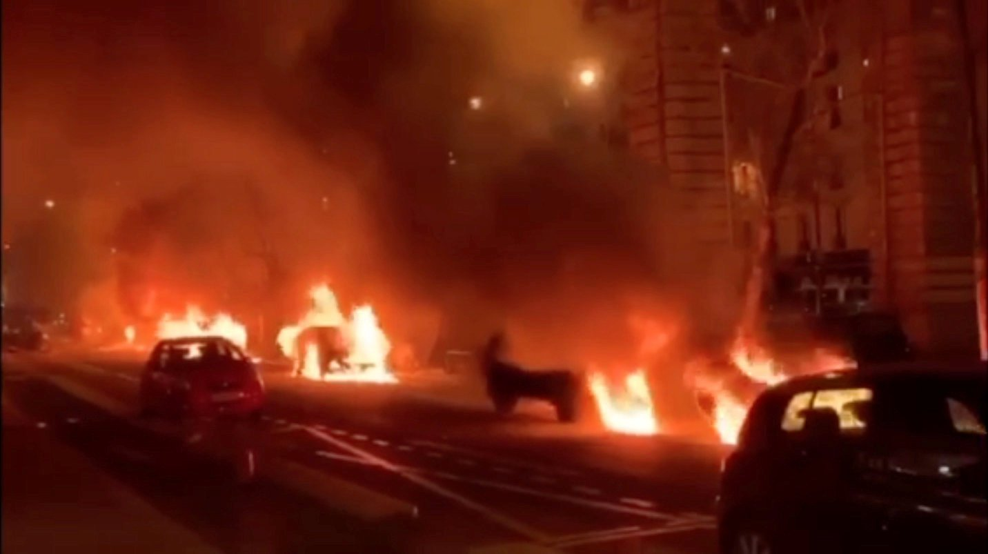 REFILE - CLARIFYING CAPTION Cars are seen burning outside the offices of Le Parisien newspaper in Paris, France, December 29, 2018, in this still image taken from a video obtained from social media. Guilhem Poincignon/via REUTERS THIS IMAGE HAS BEEN SUPPLIED BY A THIRD PARTY. NO RESALES. NO ARCHIVES.