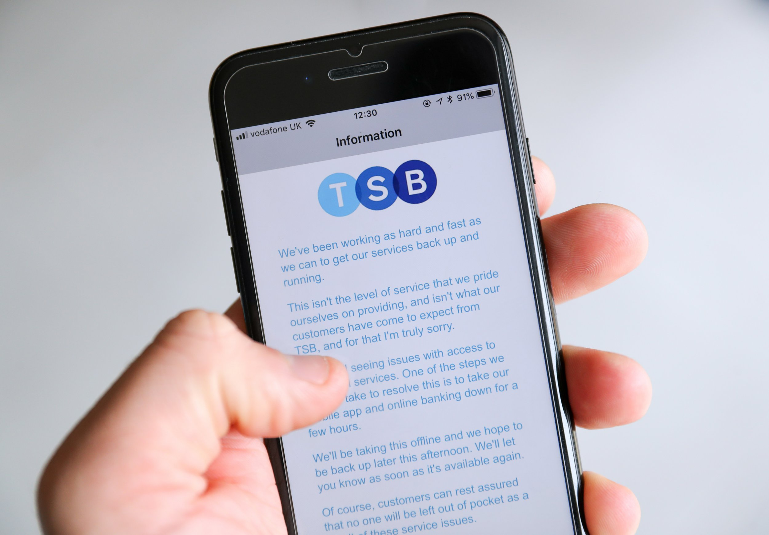A customer using the TSB Online banking app on an iPhone reads a message from TSB CEO Paul Pester apologising for IT issues which left online customers unable to access their money and some able to see other people's accounts.