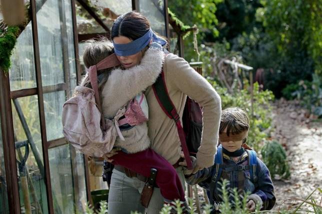 KSI thinks his bandana will save him from Bird Box monsters Credit: Netflix