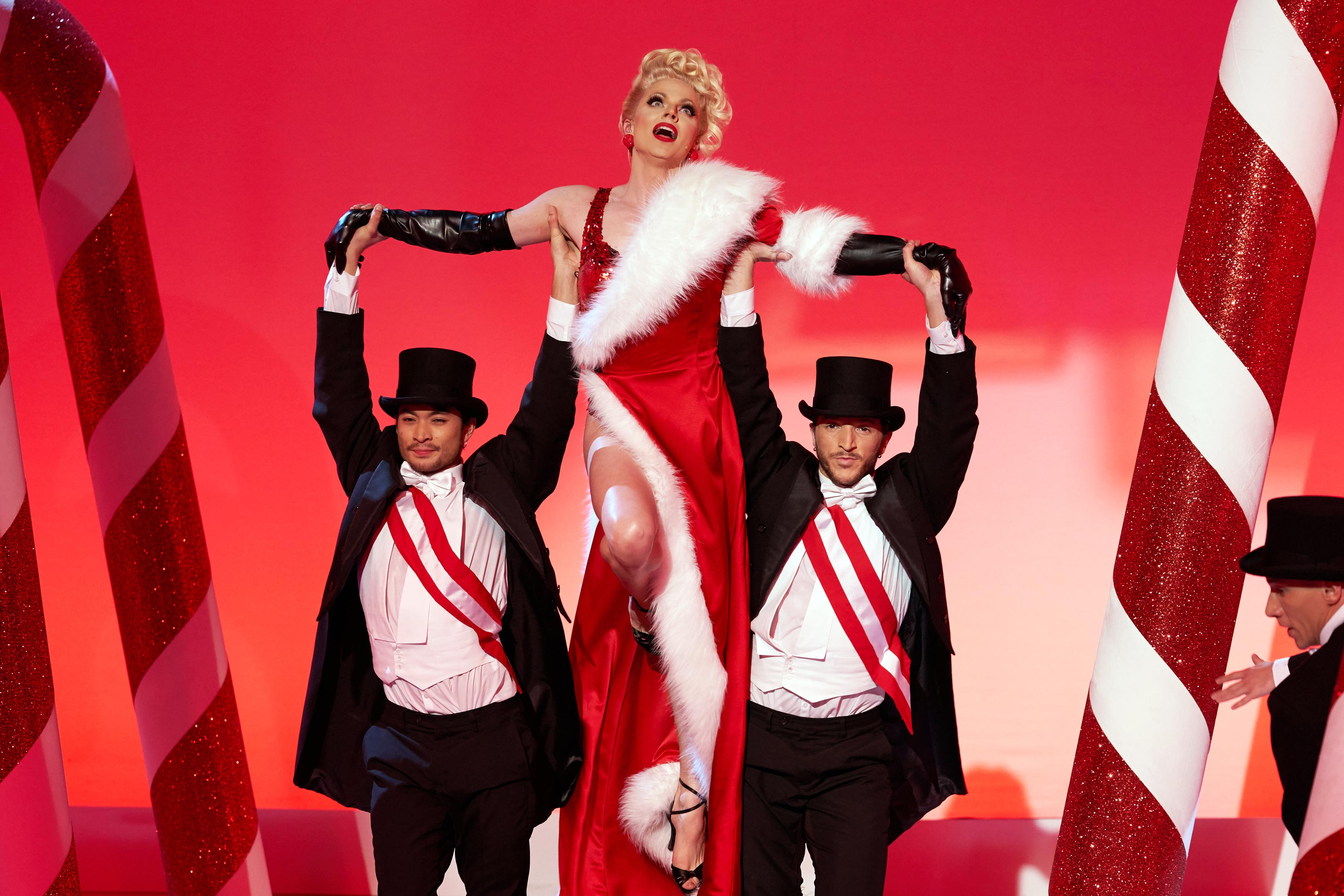 What time is Courtney Act's Christmas Extravaganza on tonight and who is appearing?