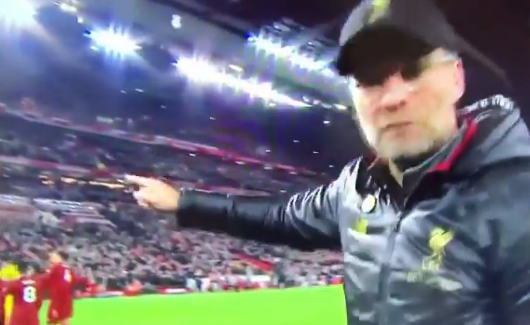 Jurgen Klopp grabs camera and points it towards Divock Origi after Liverpool win