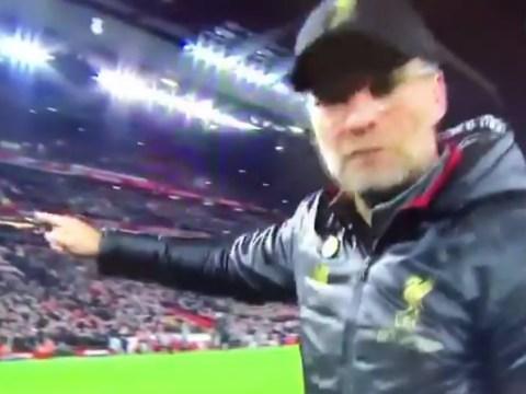 Jurgen Klopp grabs camera and points it towards Divock Origi after Liverpool win