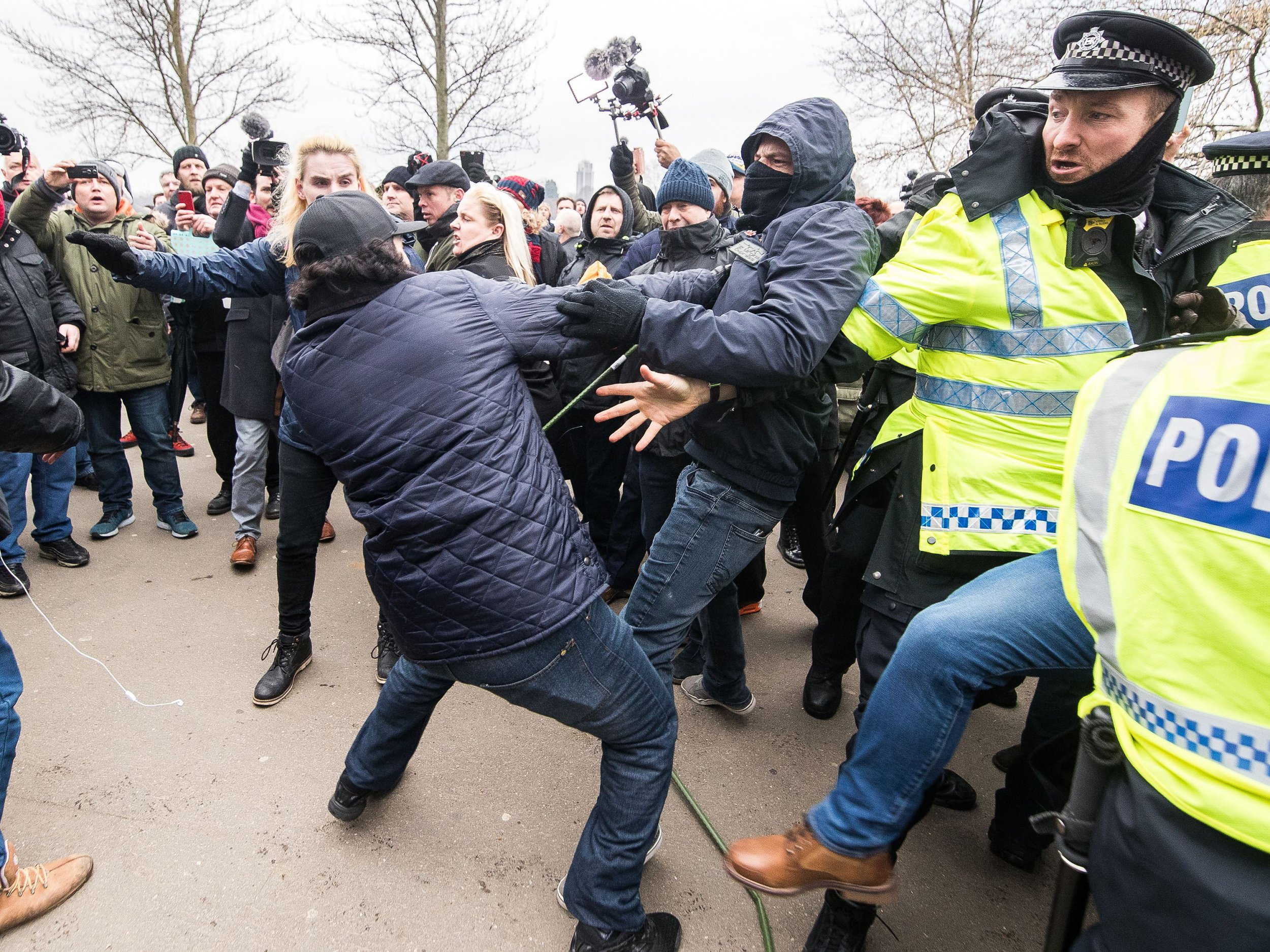 """Mandatory Credit: Photo by Joel Goodman/LNP/REX/Shutterstock (9471836j) Police intervene as supporters and those opposed to the speech fight at Speakers Corner. Alt-right groups, including Generation Identity and the Football Lads Alliance, at Speakers' Corner in Hyde Park ahead of Tommy Robinson reading a speech by Generation Identity campaigner Martin Sellner. Tommy Robinson at Speakers Corner, London, UK - 18 Mar 2018 Along with Brittany Pettibone , Sellner was due to deliver the speech last week but the pair were arrested and detained by police when they arrived in the UK , forcing them to cancel an appearance at a UKIP """" Young Independence """" youth event , which in turn was reportedly cancelled amid security concerns ."""