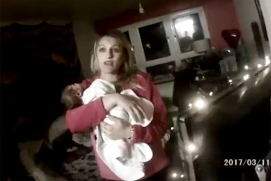 (Picture: Hampshire Constabulary) Handout still from bodycam footage dated 11/3/2017 showing Roxanne Davis holding baby Stanley after police was called to her property. Davis, 30, of Gosport, Hampshire, and ex-partner Samuel Davies, 24, of Southampton, were convicted by a jury at Winchester Crown Court of causing or allowing the death of the three week old.
