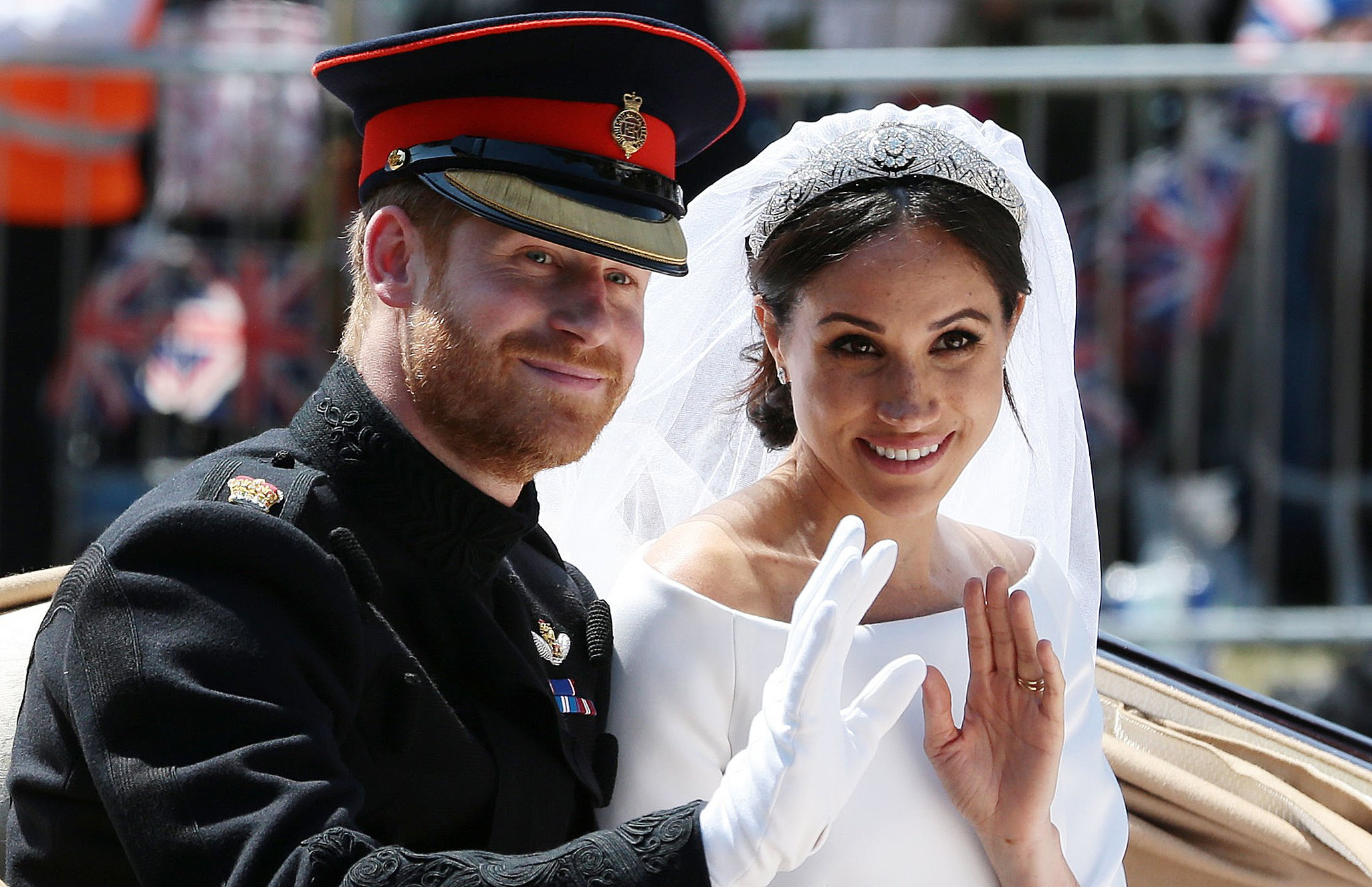 TOPSHOT - Britain's Prince Harry, Duke of Sussex and his wife Meghan, Duchess of Sussex wave from the Ascot Landau Carriage during their carriage procession on the Long Walk as they head back towards Windsor Castle in Windsor, on May 19, 2018 after their wedding ceremony. (Photo by Aaron Chown / POOL / AFP) (Photo credit should read AARON CHOWN/AFP/Getty Images)