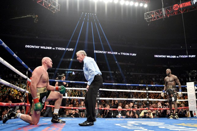 Deontay Wilder and Tyson Fury during the WBC Heavyweight Championship bout at the Staples Center in Los Angeles. PRESS ASSOCIATION Photo. Picture date: Saturday December 1, 2018. See PA story BOXING Los Angeles. Photo credit should read: Lionel Hahn/PA Wire