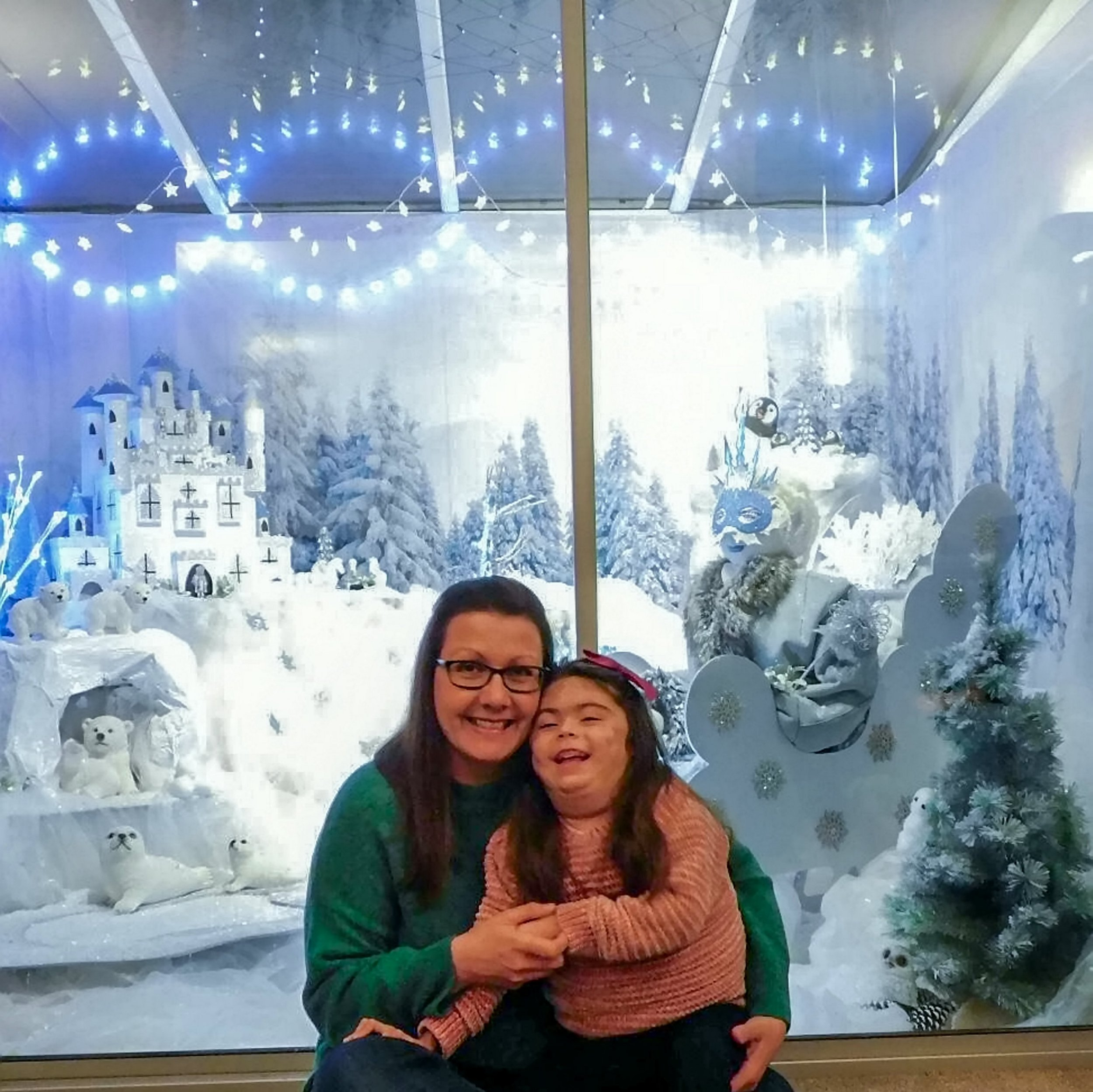Helen Sadler with her terminally ill daughter Erin and the 'Lapland' she created for her child to enjoy. See SWNS story SWCAlapland; The mum of a girl with a life-threatening condition has gone DIY to create an incredible 'Lapland' in their conservatory - after her daughter was too ill to see the real thing. Helen Sadler, 40, transformed her the room in her home into a winter wonderland after five-year-old Erin was too sick to travel to Finland to see it in real life. The mother-of-one used little Erin's old medicine packets and syringe boxes to make an impressive fairy castle.
