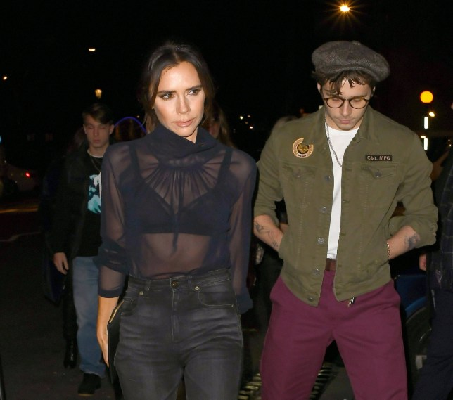 86061016857a9f Victoria Beckham braves the cold in sheer blouse as David and Brooklyn  bundle up on family night out