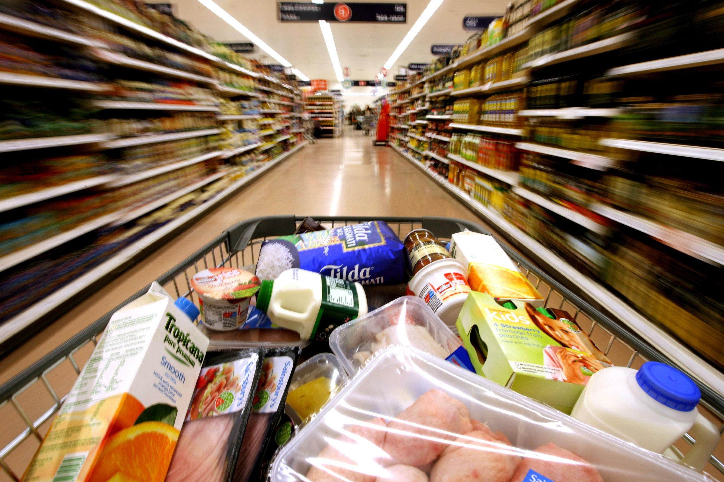 UNITED KINGDOM - FEBRUARY 29: A customer pushes a grocery cart through the food aisles at a Sainsbury's supermarket, in London Colney, U.K., on Friday, Feb. 29, 2008. J Sainsbury Plc, the third-largest U.K. supermarket chain, said sales growth slowed in the first quarter as higher living expenses in Britain cut into consumer spending on food and clothes. (Photo by Chris Ratcliffe/Bloomberg via Getty Images)