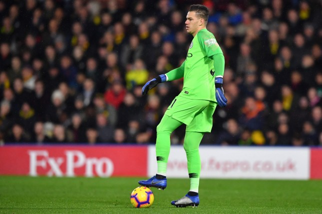 Manchester City's Brazilian goalkeeper Ederson controls the ball during the English Premier League football match between Watford and Manchester City at Vicarage Road Stadium in Watford, north of London on December 4, 2018. (Photo by Ben STANSALL / AFP) / RESTRICTED TO EDITORIAL USE. No use with unauthorized audio, video, data, fixture lists, club/league logos or 'live' services. Online in-match use limited to 120 images. An additional 40 images may be used in extra time. No video emulation. Social media in-match use limited to 120 images. An additional 40 images may be used in extra time. No use in betting publications, games or single club/league/player publications. / BEN STANSALL/AFP/Getty Images