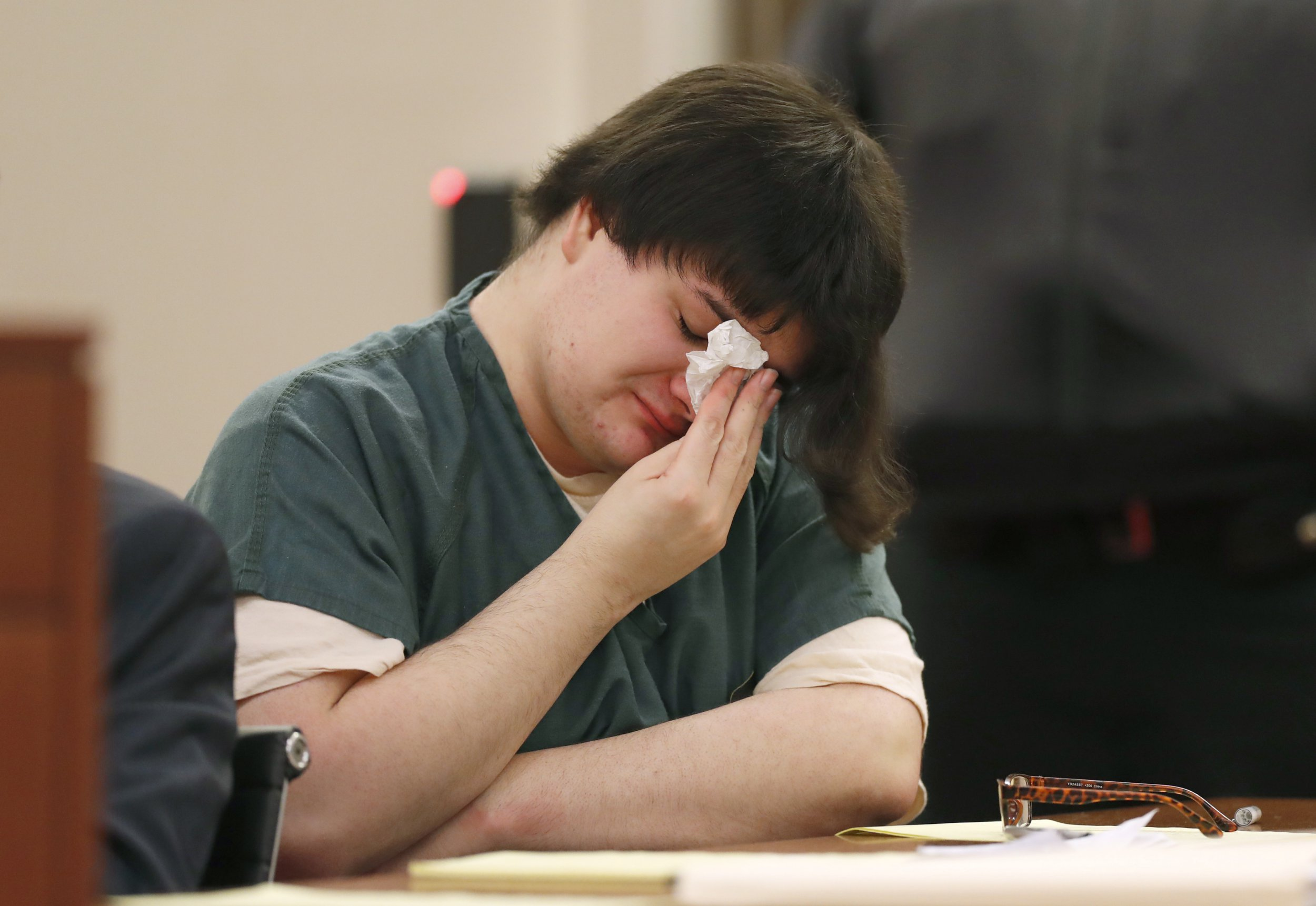 """Andrea Balcer wipes tears during her sentencing hearing for killing her parents, Tuesday, Dec. 4, 2018, at the Capital Judicial Center in Augusta, Maine. Balcer was 17 at the time of the Oct. 31, 2016, stabbings at their Winthrop home. The teenager told a police dispatcher that she """"snapped"""" on the night of the stabbings. (AP Photo/Robert F. Bukaty)"""