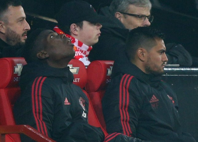 Arsenal's Paul Pogba, left, sits on the substitute bench during the English Premier League soccer match between Manchester United and Arsenal at Old Trafford stadium in Manchester, England, Wednesday Dec. 5, 2018. (AP Photo/Dave Thompson)