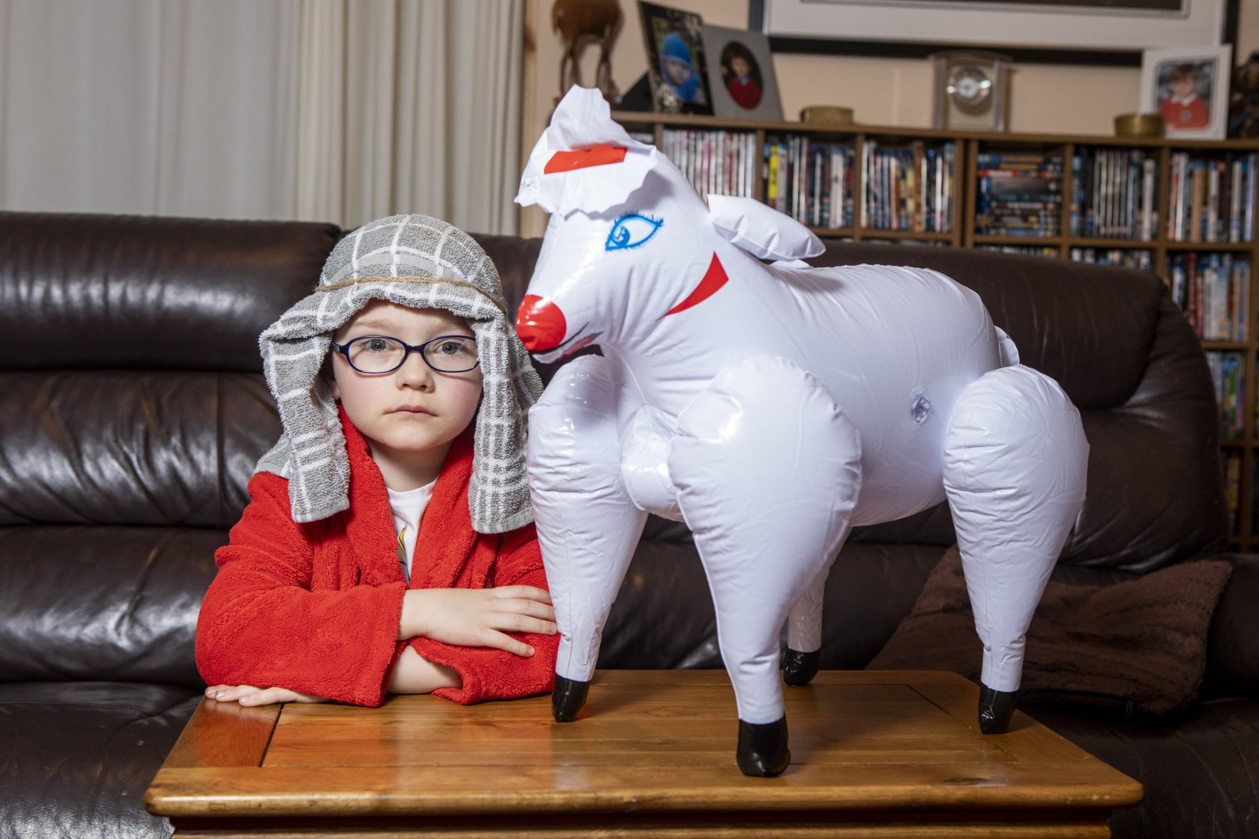 "Helen Cox's son Alfie and the inflatable sheep she bought as part of a shepherd outfit for Alfie's nativity play. When Alfie started to inflate the sheep his teachers realised it was a SEX DOLL. See SWNS story SWSYsheep; A mortified mum sent her five-year-old to his school nativity with a 'shepherd costume she bought online - before she realised it came with a blow up SEX DOLL sheep. Helen Cox, 46, bought the ?16.99 fancy dress costume from Amazon for son Alfie's school nativity, and the lad was delighted it came with a free blow up flock. She was puzzled when a teacher told the lad to ""take it home"" until she blew it up and found it had a huge hole in its bottom - as well as red lips and eyelashes. The mum-of-two found the exact same sheep was on sale as a ""stag night bonkin' sheep"" - and is now devising a way to steal it away from unaware Alfie."