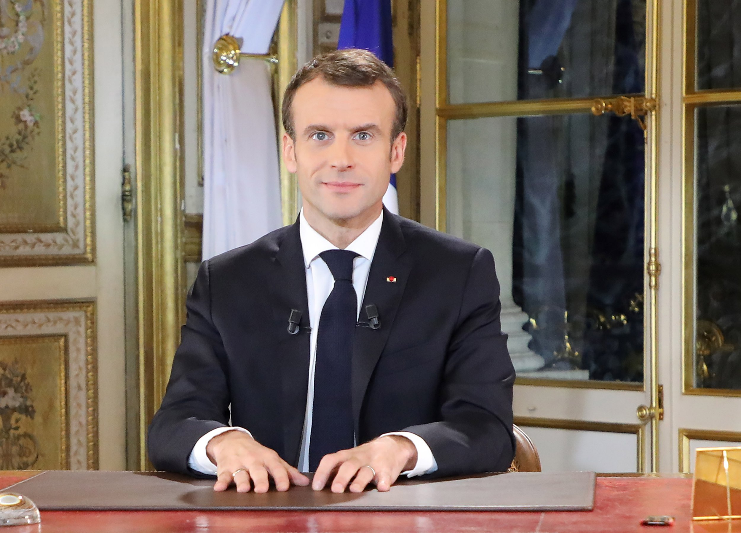 epa07222303 French President Emmanuel Macron speaks during a special address to the nation, his first public comments after four weeks of nationwide 'yellow vest' (gilet jaune) protests, at the Elysee Palace in Paris, France, 10 December 2018. Violent mass protests have been sweeping over Paris and parts of the country for more than three weeks, and riots in the downtown area surrounding the Champs Elysees and the Arc de Triomphe were ongoing between riot gear-equipped police and thousands of protesters, known as the 'Yellow Vests'. EPA/LUDOVIC MARIN / POOL MAXPPP OUT