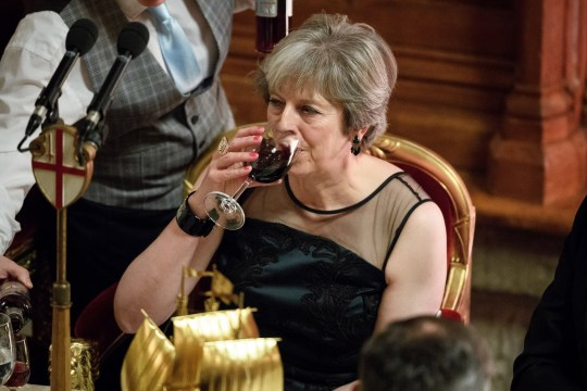 LONDON, ENGLAND - NOVEMBER 13: Britain's Prime Minister Theresa May has a drink after delivering her speech at the annual Lord Mayor's banquet on November 13, 2017 in London, England. The Prime Minister spoke of various global issues, including Russia's involvement in destablising countries and elections around the world. (Photo by Leon Neal/Getty Images)