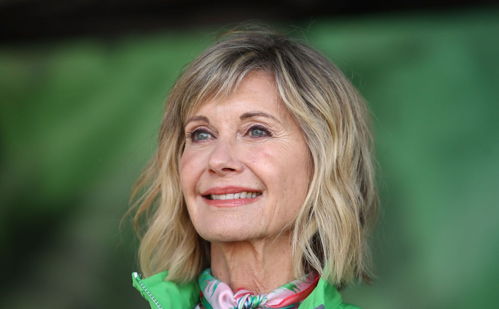 Olivia Newton-John's reps rubbish reports that Grease star is 'losing battle with cancer'
