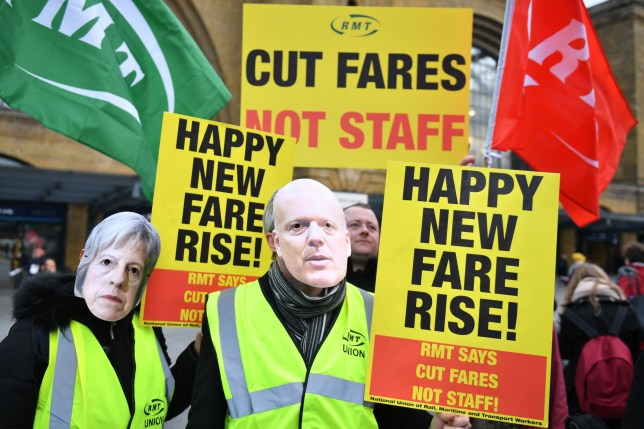 Rail protestors wearing masks with the faces of Prime Minister Theresa May and Transport Secretary Chris Grayling outside Kings Cross St Pancras station in London ahead of a visit by Labour leader Jeremy Corbyn to highlight 'rising rail fares and falling standards of service on Britain?s railways' as part of Labour?s Rail Action Day. PRESS ASSOCIATION Photo. Picture date: Wednesday January 2, 2019. See PA story RAIL Fares. Photo credit should read: Dominic Lipinski/PA Wire