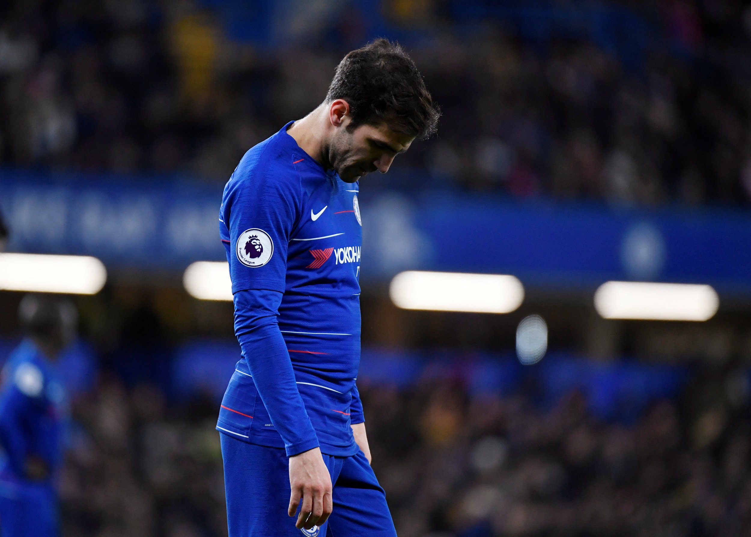 Waving goodbye? Cesc Fabregas appears to bid farewell to Chelsea fans after milestone appearance