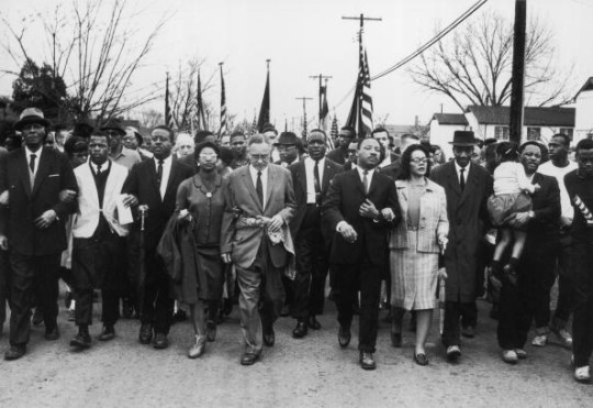 Martin Luther King and his wife Coretta Scott King lead a black voting rights march from Selma, Alabama, to the state capital in Montgomery.