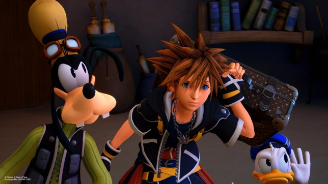 Sora standing alongside Goofy and Donald Duck in Kingdom Hearts 3