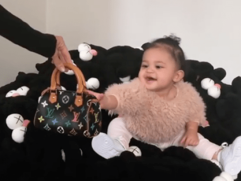 Stormi Webster reaching out for her first Louis Vuitton handbag is a real mood