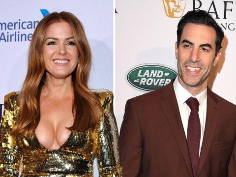 Isla Fisher steals Sacha Baron Cohen's Golden Globes glory as she jokes her boobs deserve a nod
