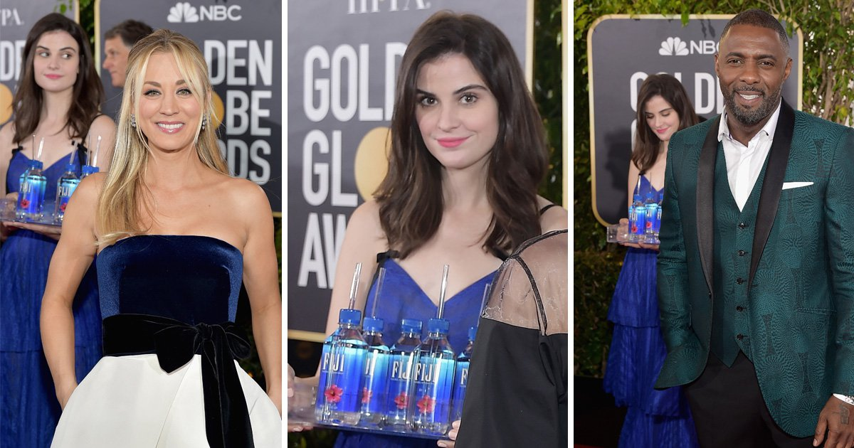 Golden Globes 2019 water bottle girl is having her moment on the red carpet and photobombs everyone