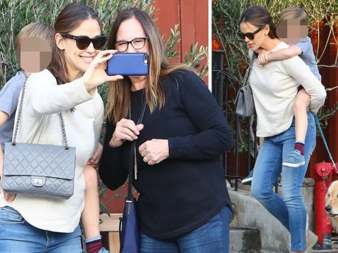 Jennifer Garner is the queen of multi-tasking as she takes selfies with fan while giving son Sam a piggyback